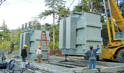 Utility workers in Alaska position a transformer manufactured by Niagara Power Transformer in Buffalo.